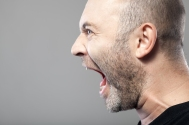 angry man screaming isolated on gray background with copyspace